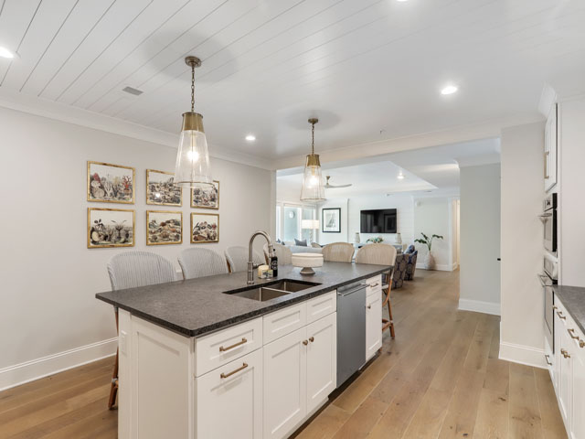 Kitchen Island flows into Living Room